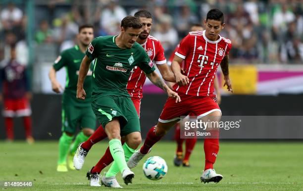 Max Kruse of Bremen is challenged by James Rodriguez of Muenchen during the Telekom Cup 2017 Final between SV Werder Bremen and FC Bayern Muenchen at...