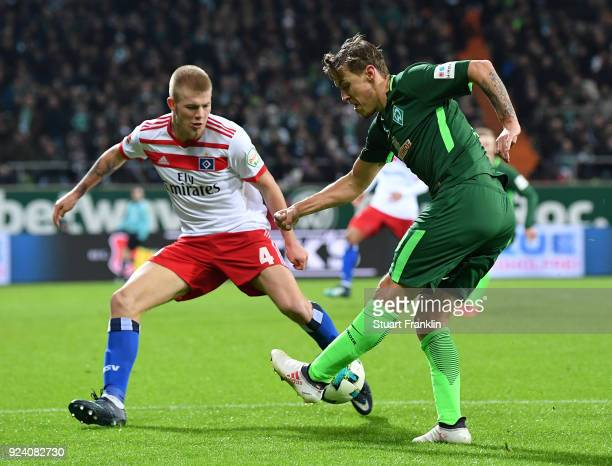 Max Kruse of Bremen is challenged by Rick Van DrongelenÊof Hamburg during the Bundesliga match between SV Werder Bremen and Hamburger SV at...