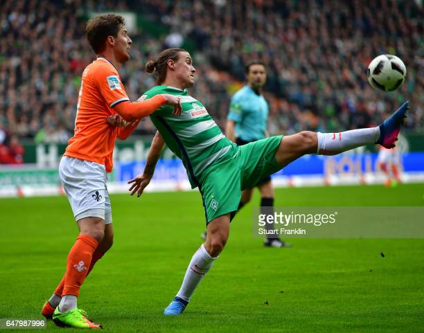 Max Kruse of Bremen is challenged bySandro Sirigu of Darmstadt during the Bundesliga match between Werder Bremen and SV Darmstadt 98 at Weserstadion...