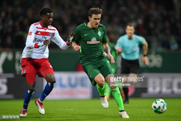 Max Kruse of Bremen is chased by Gideon Jung of Hamburg during the Bundesliga match between SV Werder Bremen and Hamburger SV at Weserstadion on...