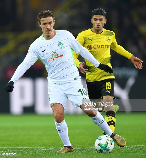 Max Kruse of Bremen is chased by Mahmoud Dahoud of Dortmund during the Bundesliga match between Borussia Dortmund and SV Werder Bremen at Signal...