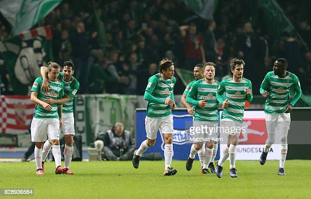 Max Kruse of Bremen jubilates with team mates after scoring the first goal during the Bundesliga match between Hertha BSC and SV Werder Bremen at...