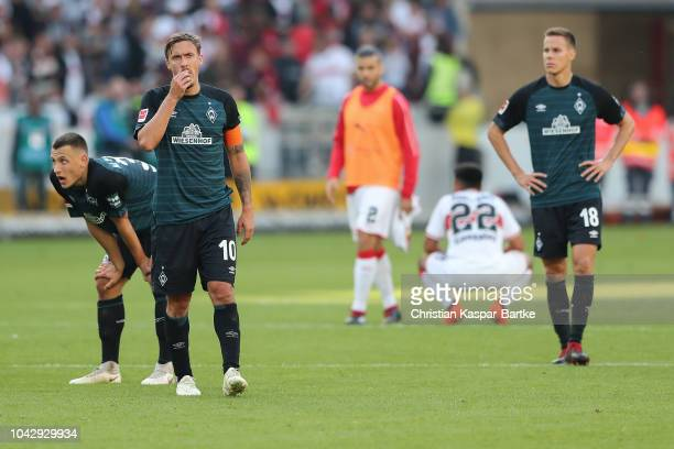 Max Kruse of Bremen Maximilian Eggestein of Bremen and Niklas Moisander of Bremen react disappointed after the Bundesliga match between VfB Stuttgart...