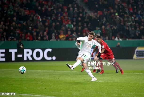 Max Kruse of Bremen scores the opening goal by penalty kick during the DFB Cup quarter final match between Bayer Leverkusen and Werder Bremen at...
