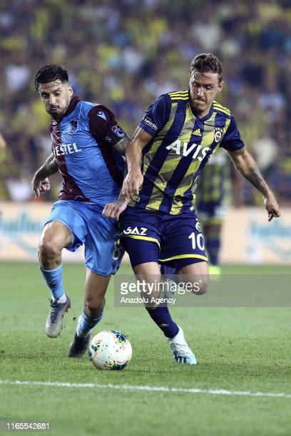 Max Kruse of Fenerbahce in action against Jose Sosa of Trabzonspor during Turkish Super Lig week 3 match between Fenerbahce and Trabzonspor at Ulker...