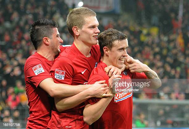 Max Kruse of Freiburg celebrates his second goal with Marco Terrazzino and Matthias Ginter during the Bundesliga match between SC Freiburg and VfL...