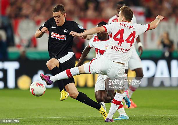Max Kruse of Freiburg is challenged by Alexandru Maxim of Stuttgart during the DFB Cup Semi Final match between VfB Stuttgart and SC Freiburg at...