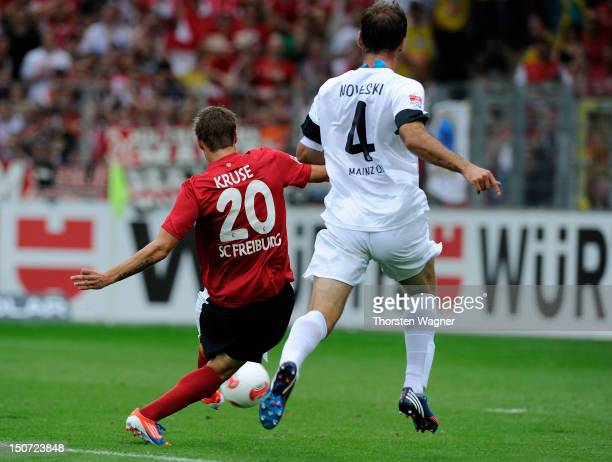 Max Kruse of Freiburg is scoring his teams first goal during the Bundesliga match between SC Freiburg and FSV Mainz 05 at Mage Solar stadium on...