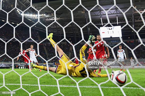 Max Kruse of Germany shoots past goalkeeper Nukri Revishvili of Georgia to score their second goal during the UEFA EURO 2016 Group D qualifying match...