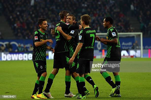 Max Kruse of Gladbach celebrate with his team mates after he scores his teams 2nd goall during the Bundesliga match between Hamburger SV and Borussia...
