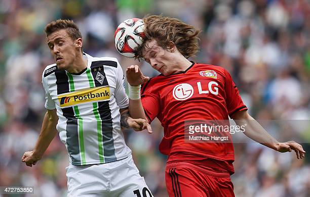 Max Kruse of Gladbach jumps for a header with Tin Jedvaj of Leverkusen during the Bundesliga match between Borussia Moenchengladbach and Bayer 04...