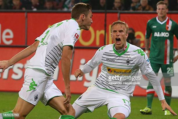 Max Kruse of Moenchengladbach celebrates scoring the second team goal with his team mate Oscar Wendt during the Bundesliga match between FC Augsburg...