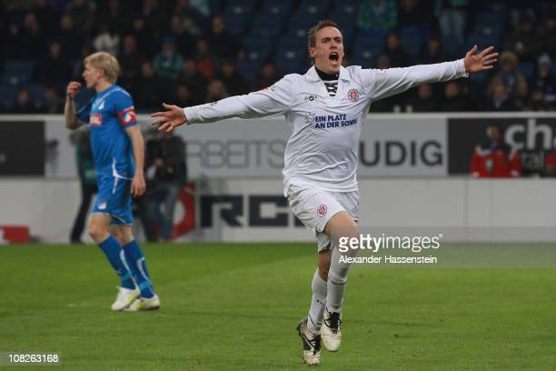 Max Kruse of St Pauli celebrates scoring the first team goal whilst Andreas Beck of Hoffenheim looks dejected during the Bundesliga match between...