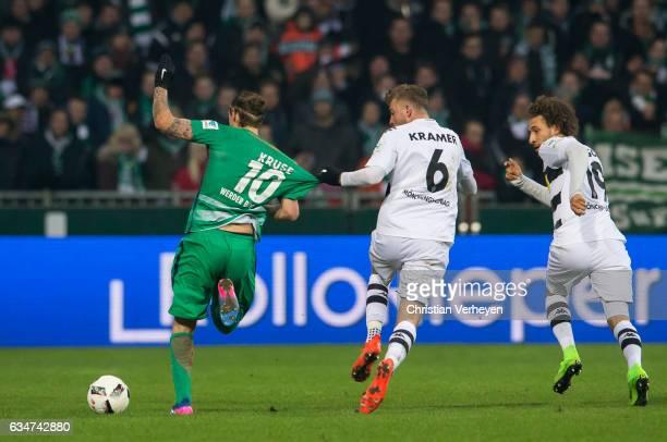 Max Kruse of Werder Bremen and Christoph Kramer of Borussia Moenchengladbach battle for the ball during the Bundesliga match between Werder Bremen...