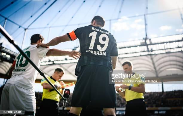 Max Kruse of Werder Bremen and David Abraham of Frankfurt shake hands during the Bundesliga match between Eintracht Frankfurt and SV Werder Bremen at...