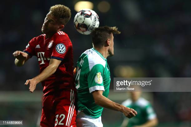 Max Kruse of Werder Bremen and Joshua Kimmich of Bayern Munich battle for possession during the DFB Cup semi final match between Werder Bremen and FC...