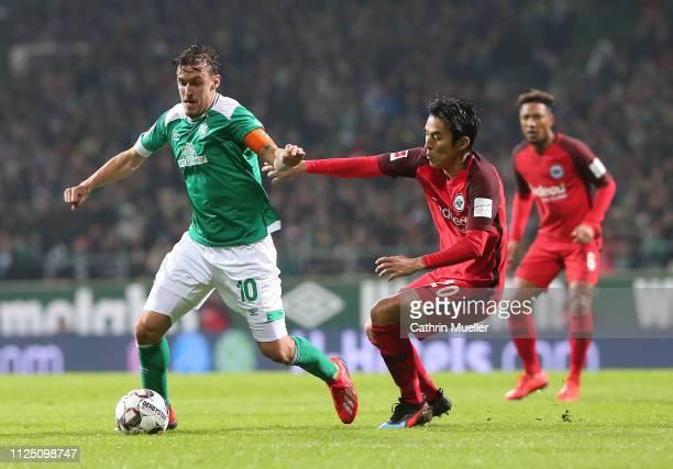 Max Kruse of Werder Bremen and Makoto Hasebe of Eintracht Frankfurt during the Bundesliga match between SV Werder Bremen and Eintracht Frankfurt at...