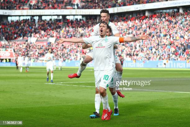Max Kruse of Werder Bremen celbrates after he scores his sides third goal during the Bundesliga match between Bayer 04 Leverkusen and SV Werder...
