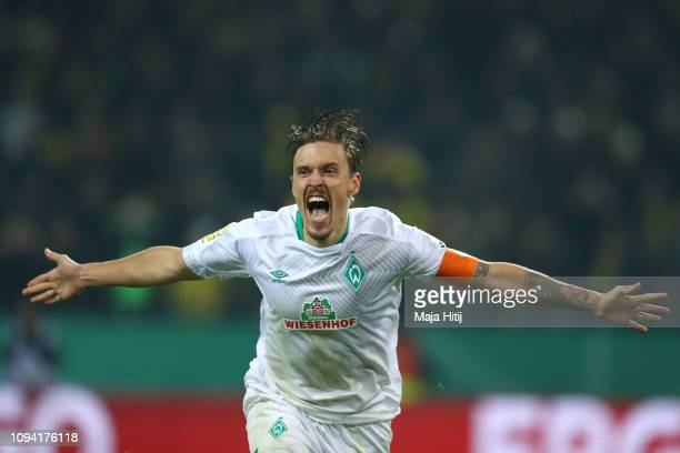 Max Kruse of Werder Bremen celebrates after he scores his sides winning penalty in the penalty shoot out during the DFB Cup match between Borussia...