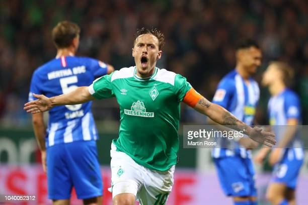Max Kruse of Werder Bremen celebrates after scoring a penalty and his team's third goal during the Bundesliga match between SV Werder Bremen and...