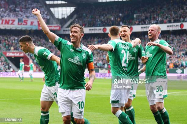 Max Kruse of Werder Bremen celebrates after scoring his team's second goal during the Bundesliga match between SV Werder Bremen and 1 FSV Mainz 05 at...