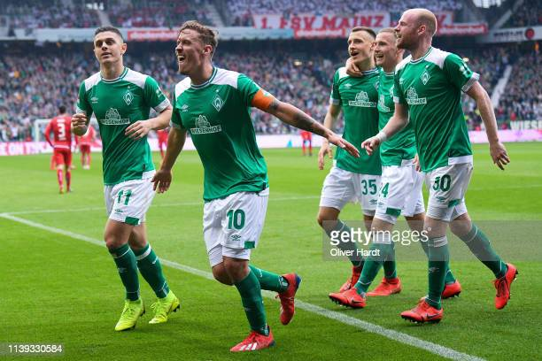 Max Kruse of Werder Bremen celebrates after scoring his team's second goal during the Bundesliga match between SV Werder Bremen and 1 FSV Mainz 05 at...