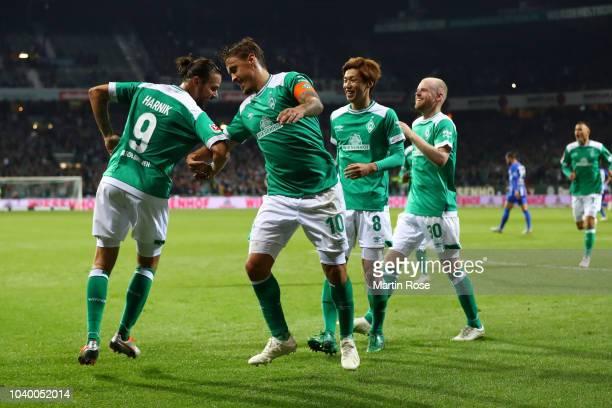 Max Kruse of Werder Bremen celebrates after scoring his team's third goal during the Bundesliga match between SV Werder Bremen and Hertha BSC at...