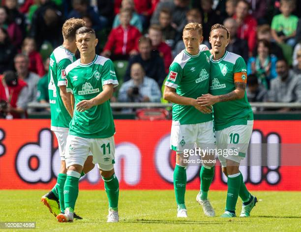 Max Kruse of Werder Bremen celebrates with team mates after scoring a goal against goalkeeper Sergio Asenjo of FC Villareal during the Pre Season...