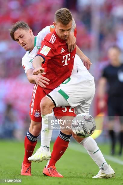 Max Kruse of Werder Bremen challenges Joshua Kimmich of Bayern Munich during the Bundesliga match between FC Bayern Muenchen and SV Werder Bremen at...