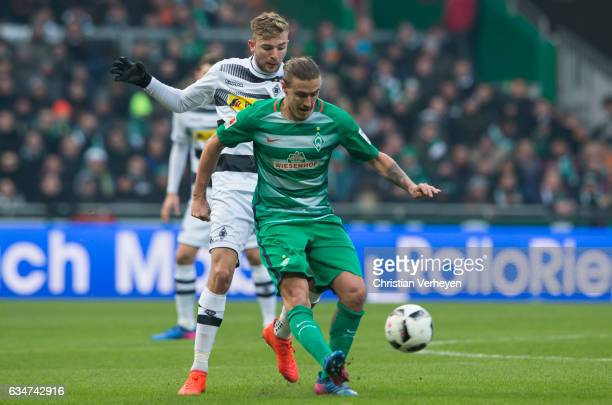Max Kruse of Werder Bremen is chased by Christoph Kramer of Borussia Moenchengladbach during the Bundesliga match between Werder Bremen and Borussia...