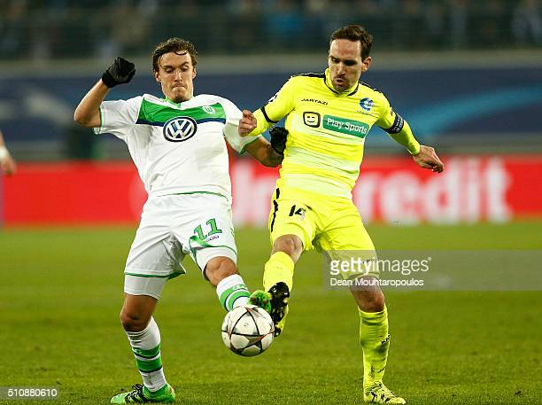 Max Kruse of Wolfsburg and Sven Kums of KAA Gent battle for the ball during the UEFA Champions League round of 16 first leg match between KAA Gent...