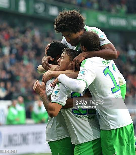 Max Kruse of Wolfsburg celebrates after scoring his teams third goal with Luiz Gustavo Dante and Bas Dost of Wolfsburg during the Bundesliga match...