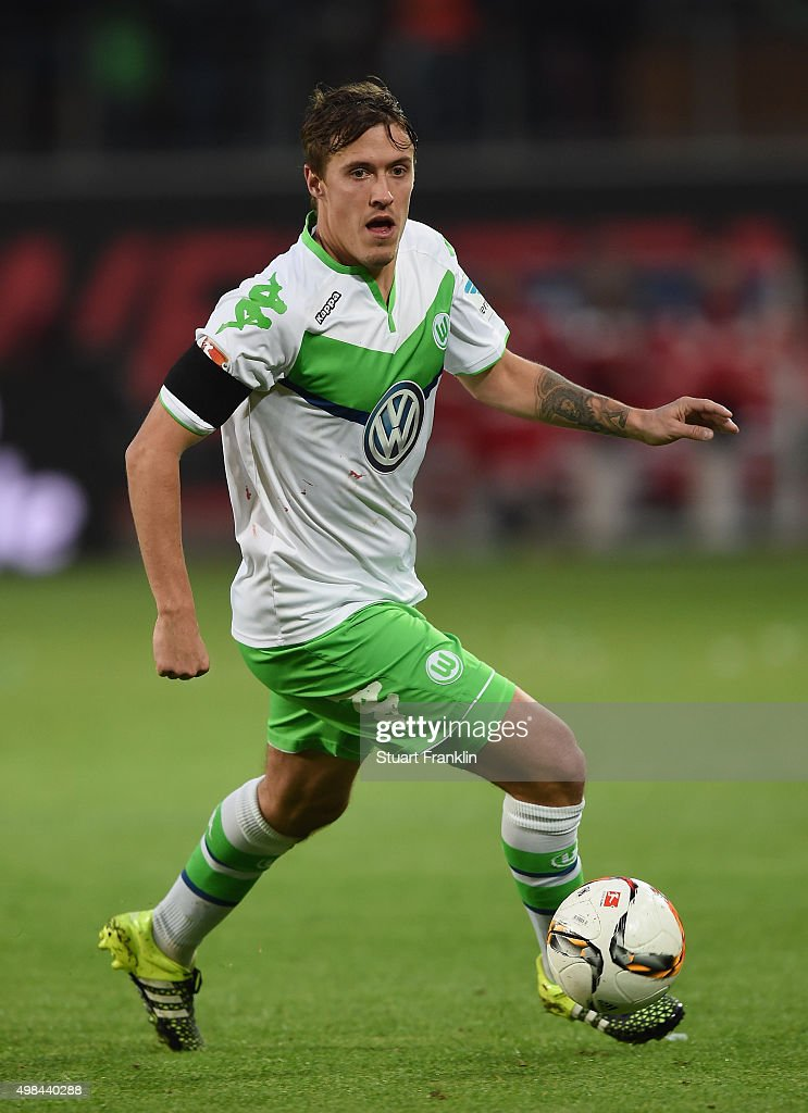 Max Kruse of Wolfsburg is challenged by of Bremen during the Bundesliga match between VfL Wolfsburg and Werder Bremen at Volkswagen Arena on November 21, 2015 in Wolfsburg, Germany.