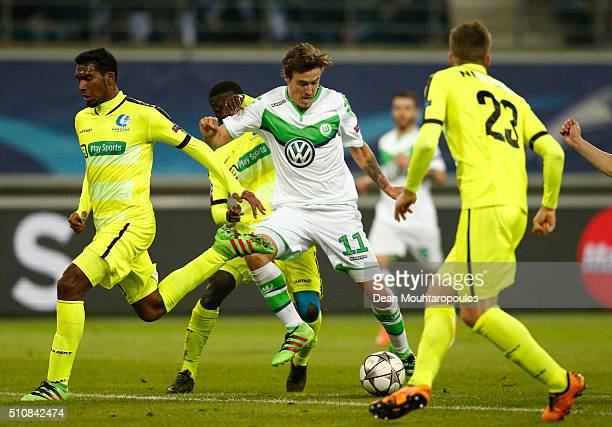 Max Kruse of Wolfsburg is closed down during the UEFA Champions League round of 16 first leg match between KAA Gent and VfL Wolfsburg at Ghelamco...