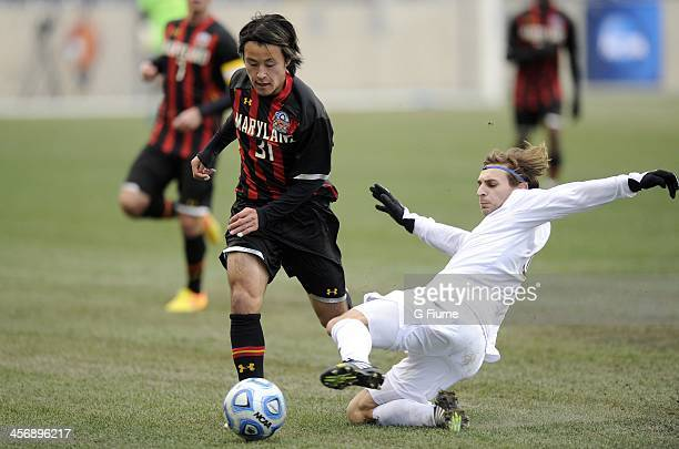 Max Lachowecki of the Notre Dame Fighting Irish battles for the ball against Tsubasa Endoh of the Maryland Terrapins during the 2013 NCAA Men's...