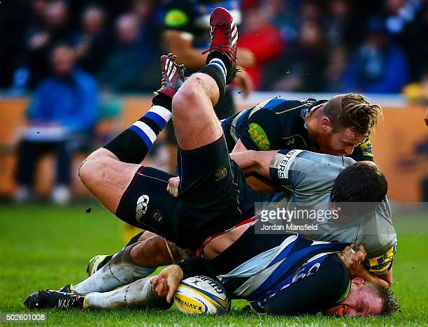 Max Lahiff of Bath is tackled by Donncha O'Callaghan of Worcester during the Aviva Premiership match between Bath Rugby and Worcester Warriors at the...