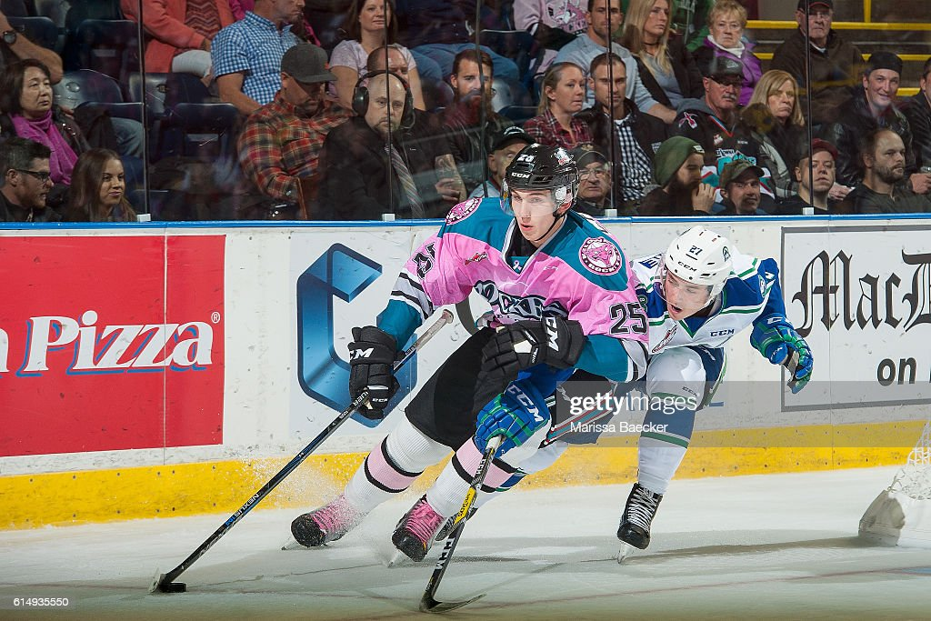 Max Lajoie #27 of Swift Current Broncos stick checks Cal Foote #25 of Kelowna Rockets on October 15, 2016 at Prospera Place in Kelowna, British Columbia, Canada.