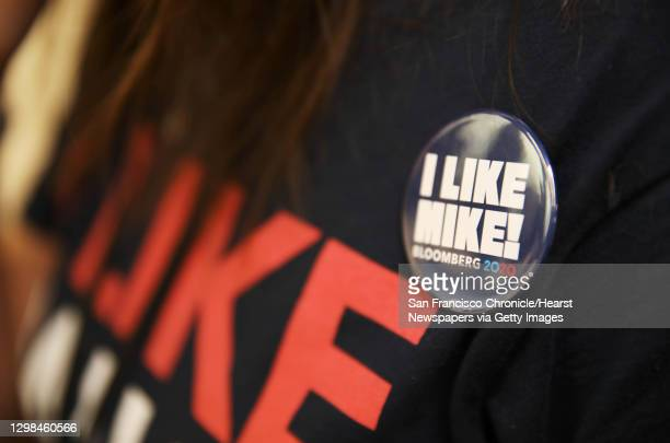 "Max Larson wears a """"I Like Mike!"""" Button on her t-shirt as she works the phone bank at the Mike Bloomberg Oakland office, located at 1504 Franklin..."