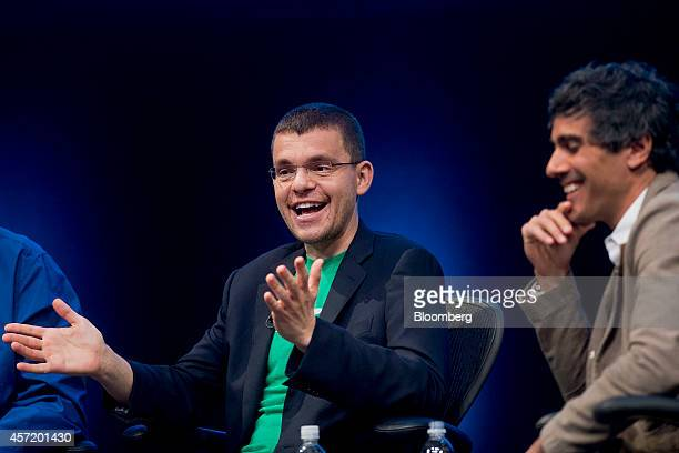 Max Levchin, co-founder of PayPal Inc. And chairman of Kaggle Inc., left, speaks as Jeremy Stoppelman, chief executive officer and co-founder of Yelp...
