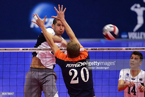 Max Lipsitz of the Penn State Nittany Lions hits the ball against Mark Hulse of the Pepperdine Waves in the second set of their 2008 NCAA National...
