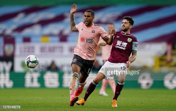 Max Lowe of Sheffield United battles for possession with Robbie Brady of Burnley during the Carabao Cup second round match between Burnley and...