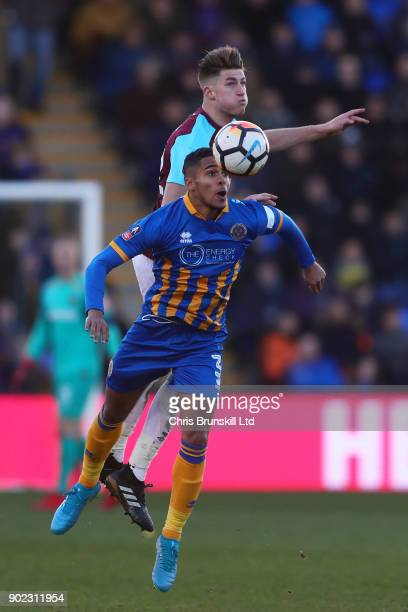 Max Lowe of Shrewsbury Town in action with Reece Burke of West Ham United during The Emirates FA Cup Third Round match between Shrewsbury Town and...