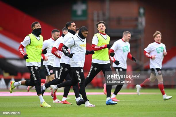 Max Lowe, Rhian Brewster and Ethan Ampadu of Sheffield United warm up prior to the Premier League match between Sheffield United and Southampton at...
