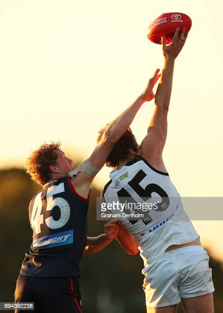 Max Lynch of Collingwood and Declan Keilty of the Casey Demons compete for the ball during the round eight VFL match between Casey Demons and...