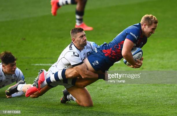 Max Malins of Bristol Bears evades the tackle of Kyle Moyle of Gloucester Rugby before going over to score their sides second try during the...