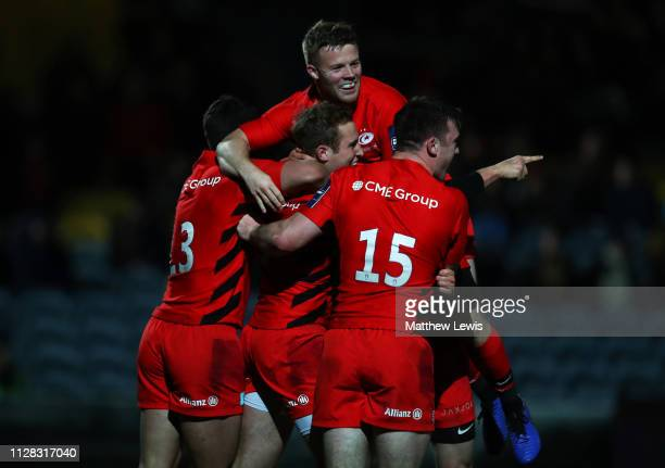 Max Malins of Saracens celebrates with team mates as he scores their the third try during the Premiership Rugby Cup semifinal match between Worcester...