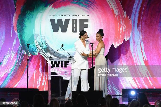Max Mara Vice President US Retail and Global Brand Ambassador Maria Giulia Maramotti and Regina Hall speak onstage during the Women In Film 2018...