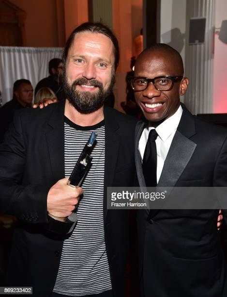Max Martin and Spotify global head of creator services Troy Carter attend Spotify's Inaugural Secret Genius Awards hosted by Lizzo at Vibiana on...