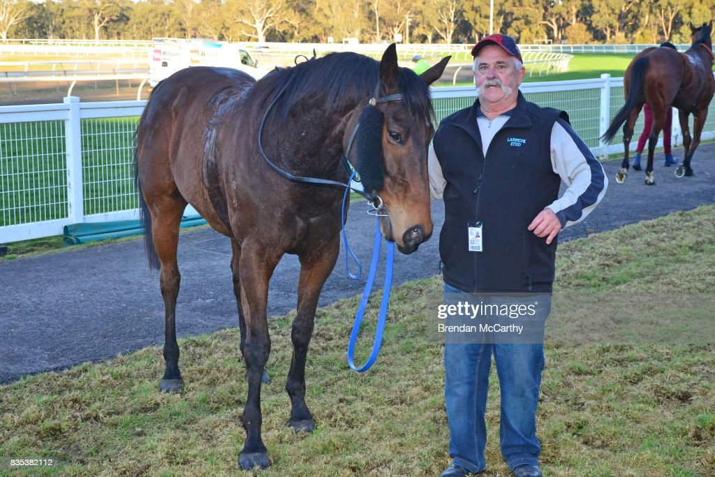 Max Master and strapper Gary Parkinson after winning the Parker Bros. Earthmoving 0 - 58 Handicap at Seymour Racecourse on August 19, 2017 in Seymour, Australia.