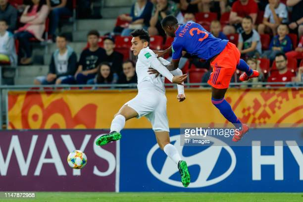 Max Mata of New Zealand and Andres Reyes of Colombia battle for the ball during the 2019 FIFA U20 World Cup Round of 16 match between Colombia and...